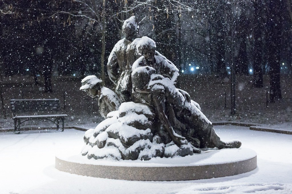 Snow falls on the Vietnam Women's Memorial. Photograph by Harrison Jones.