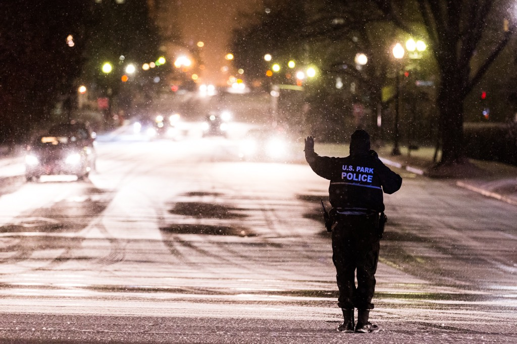 U.S. Park Police help guide traffic in Washington, DC. Traffic was bad in many parts of the area. Photograph by Harrison Jones.
