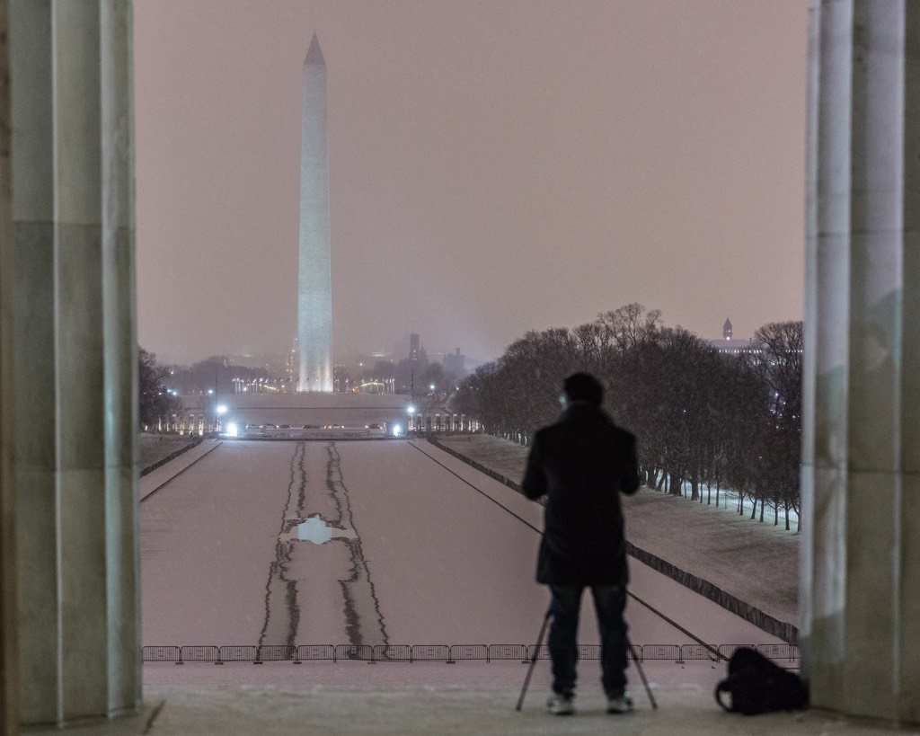 Snow falls on the National Mall. Photograph by Harrison Jones.