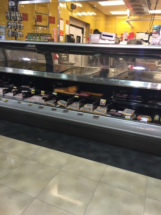 The empty deli counter at a DC Harris Teeter. Photograph by Callan Mathis.