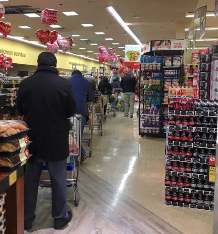 The long check-out line at a Reston supermarket. Photograph courtesy of Dorothy West.