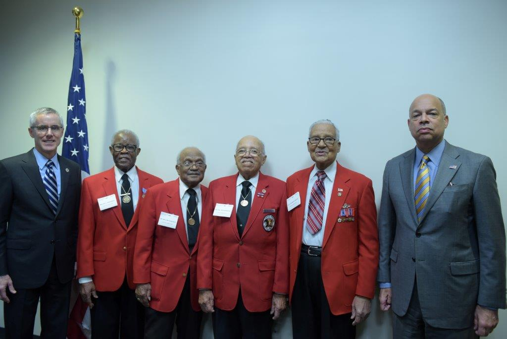 Tuskegee Airmen, in red, from left to right: Major L. Anderson, William T. Fauntroy Jr., Walter K. Robinson, Colonel Charles E. McGee
