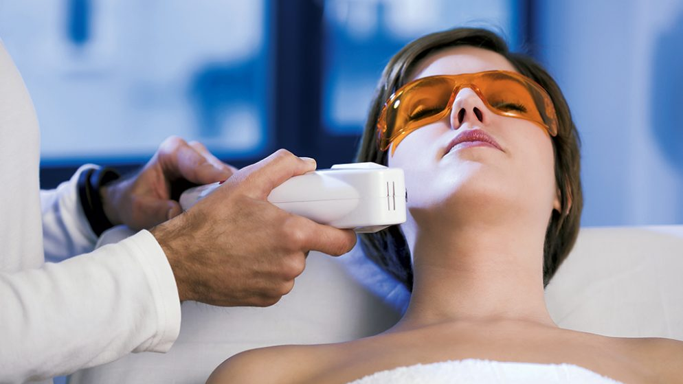 Laser hair removal. Photograph by Thomas EyeDesign/Getty Images.