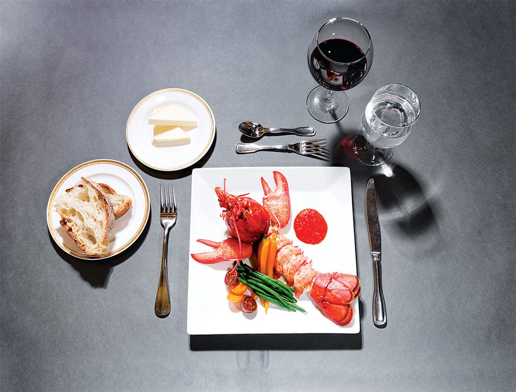 DC cafeteria meals: Charbroiled Maine lobster with marjoram butter sauce in a tomato concassé. Photograph by Andrew Propp.