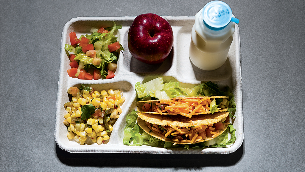 DC cafeteria meals: Turkey tacos with corn salsa and green salad, apple, and milk. Photograph by Andrew Propp.