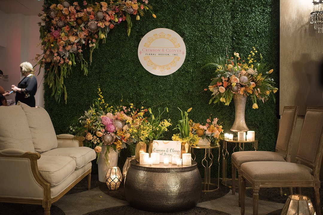 Crimson & Clover Floral Design created a relaxing and intimate space for guests at their booth.