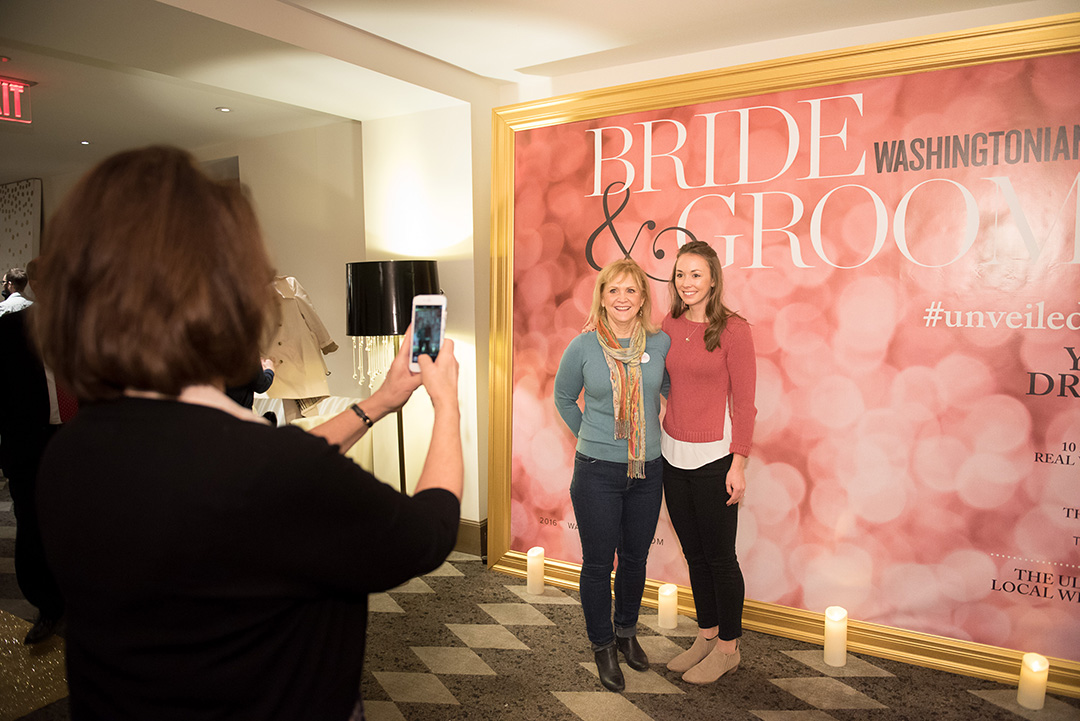 Attendees posed in front of the faux Washingtonian Bride & Groom cover created by Revolution Events.