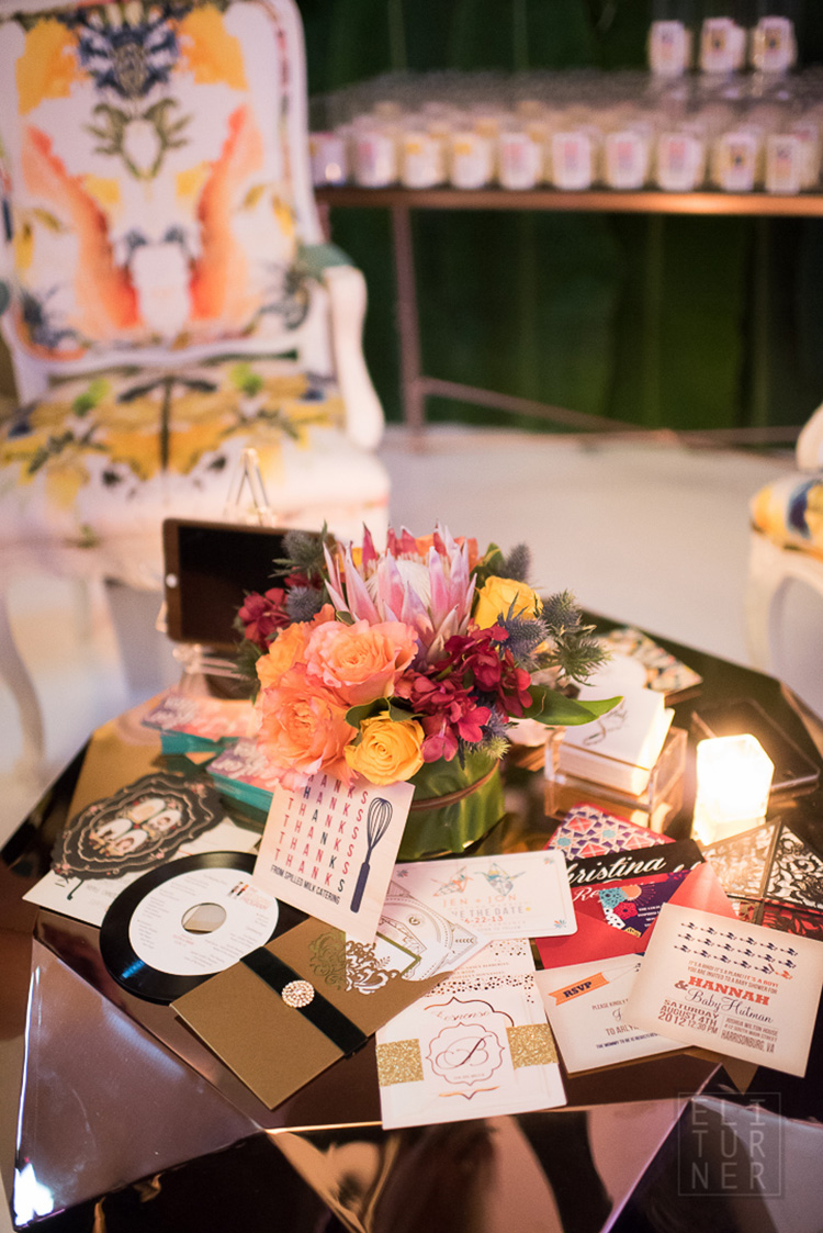Taylor and Hov Events + Design set up a beautiful display of invitations on a coffee table in their booth.