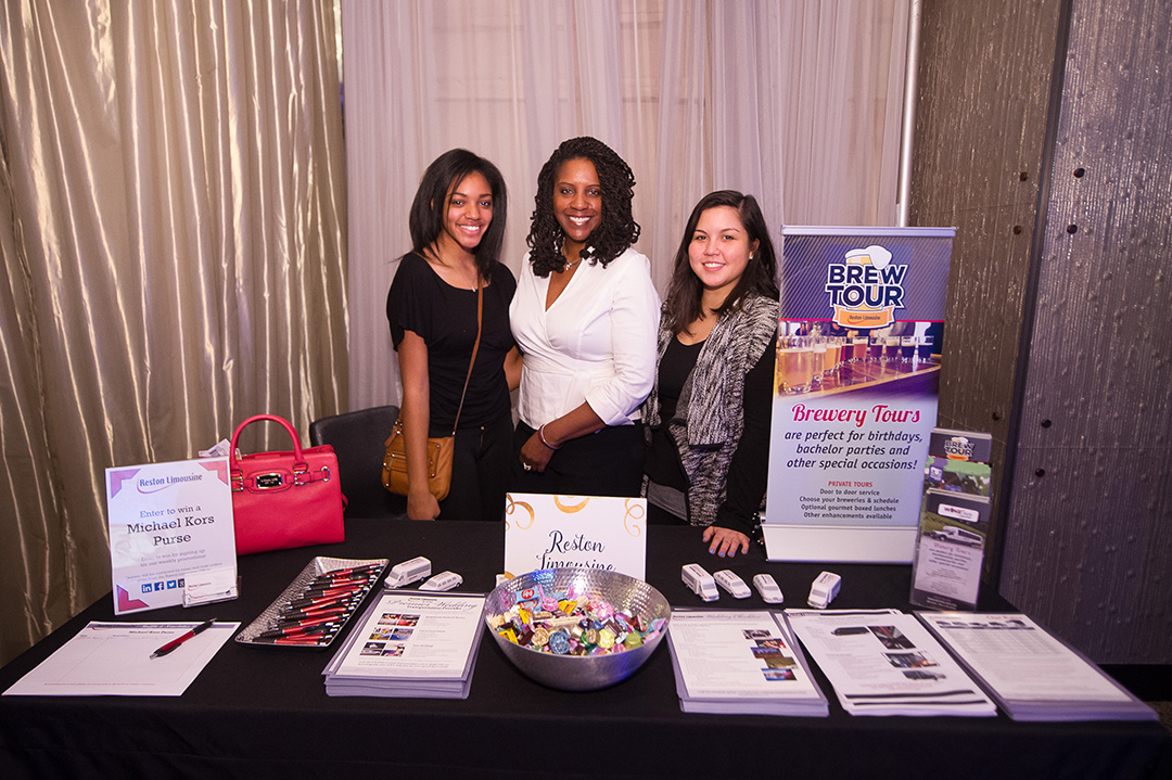 The ladies from Reston Limousine talked to guests about wedding day transportation and private brewery tours.