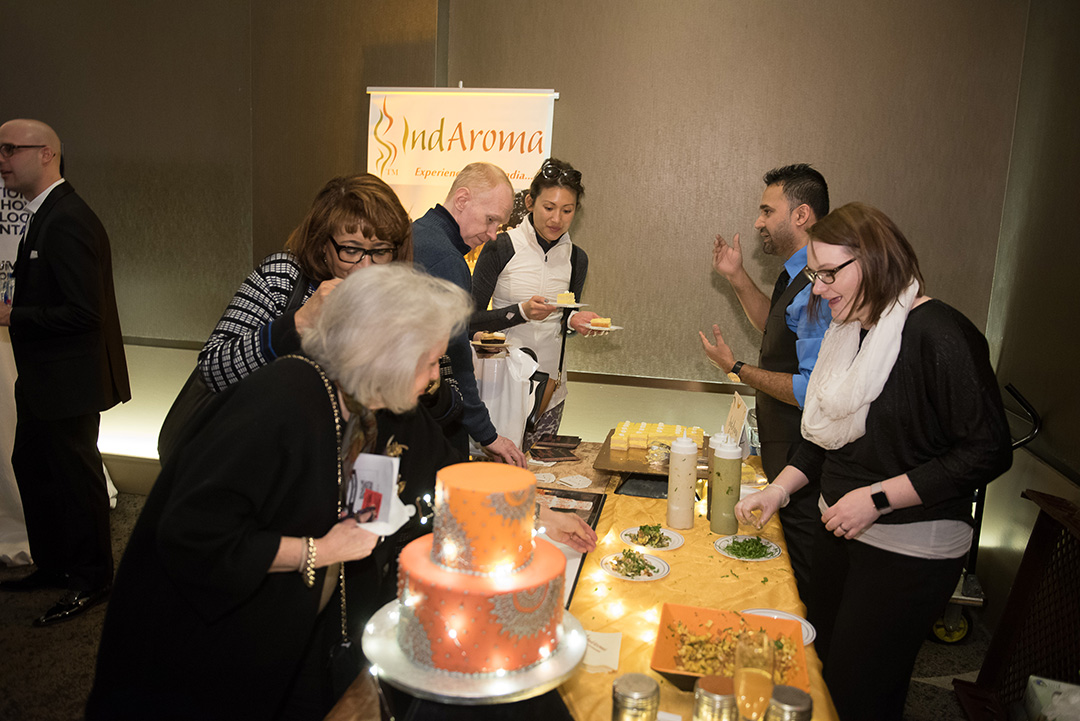 Hungry attendees sampled delicious food from IndAroma catering.