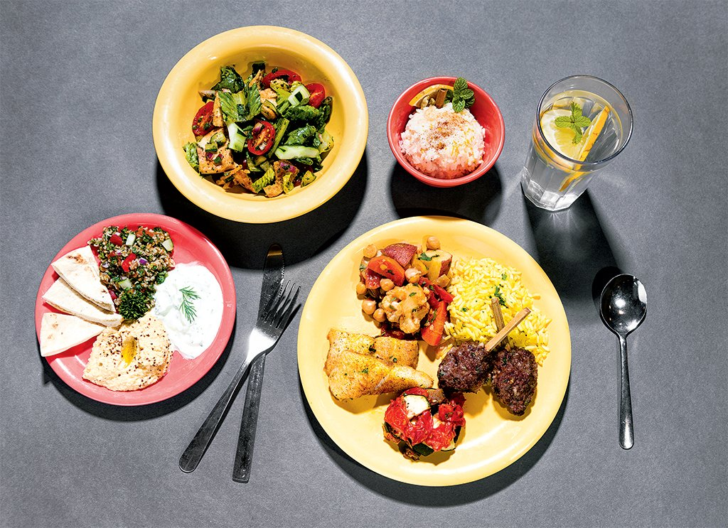 DC cafeteria meals: Middle Eastern feast with lamb and beef kofta kebabs, fattoush salad, and Persian rice pudding. Photograph by Andrew Propp.