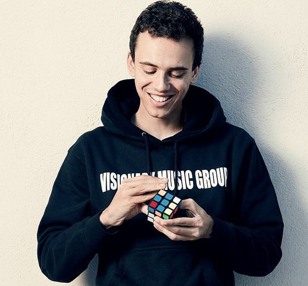 Logic has a thing for Rubik's Cubes—he owns dozens and likes to solve them while he raps. Photograph by Emily Shur.