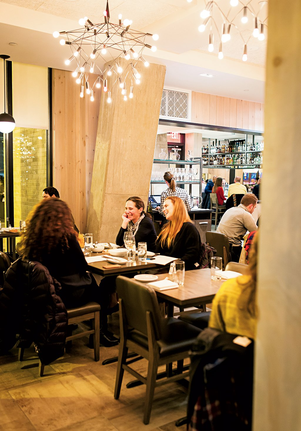 At Convivial in Shaw, Washington, DC, diners can share plates of scallop boudin blanc with snow peas and trout roe (opposite left) or pickled rockfish with green papaya and winter radish. Photograph by Scott Suchman.