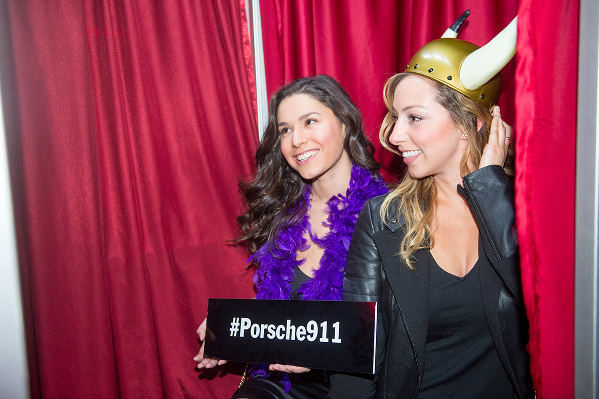Guests pose in the photo booth provided by Booth-o-Rama.