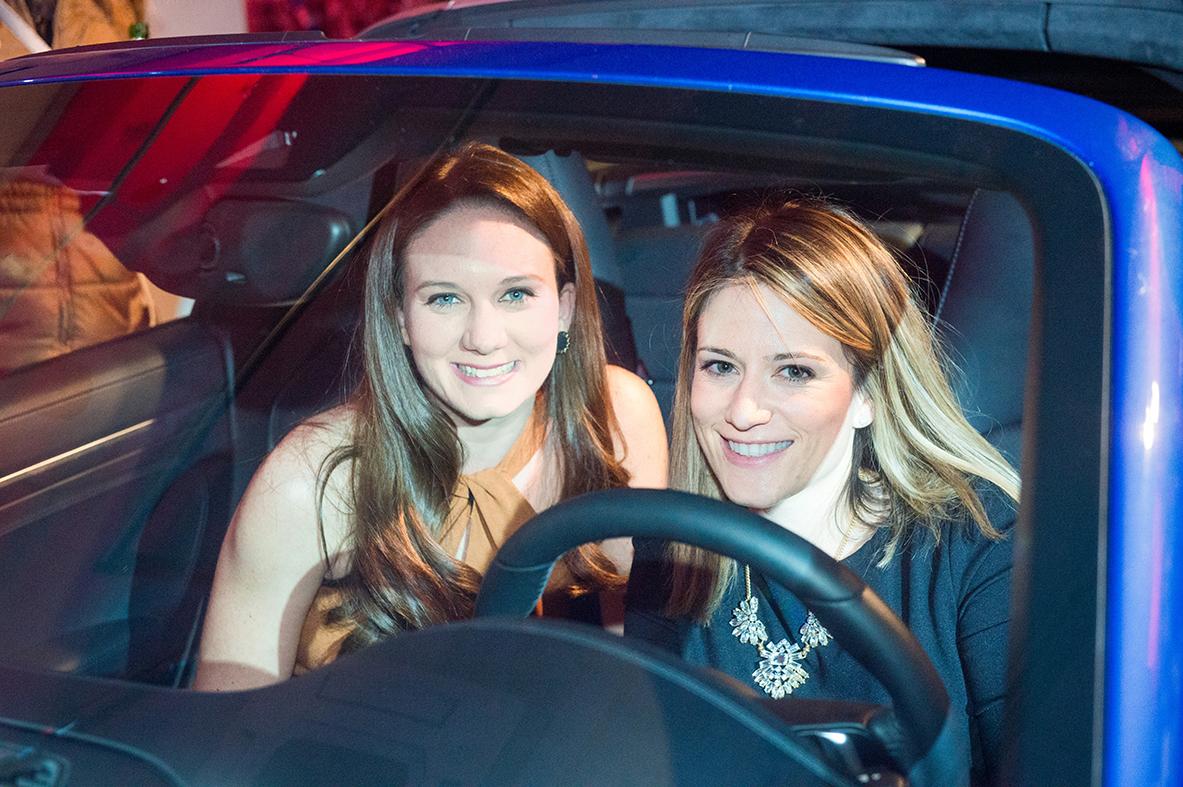 Jessie Eddington and Meg Lundquist pose in the new Porsche 911.