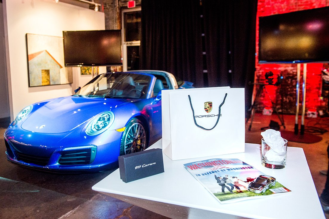 Attendees enjoyed the Porsche 911 reveal and took home a gift bag with a Porsche paper weight, whiskey glass, and a copy of the Washingtonian.