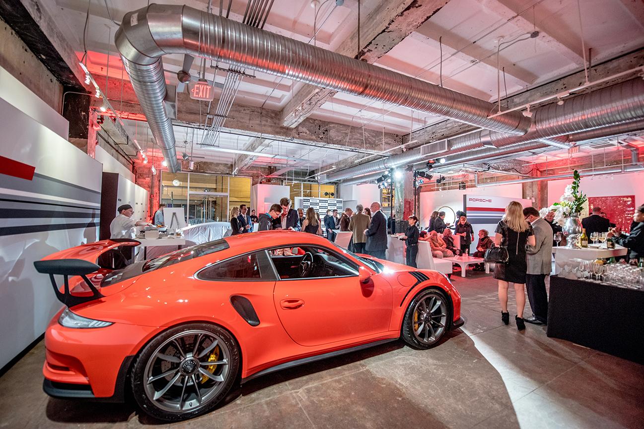 The 2016 Porsche 911 GT3 RS in Lava Orange is a street legal race car.