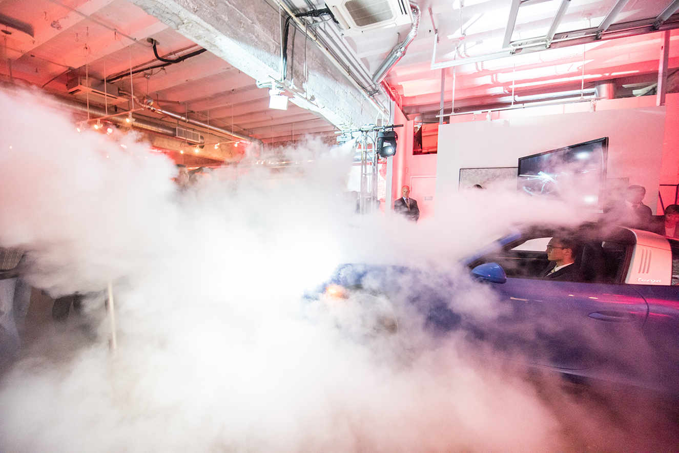 The new Porsche 911 drove through a cloud of smoke and into the gallery during the big reveal.