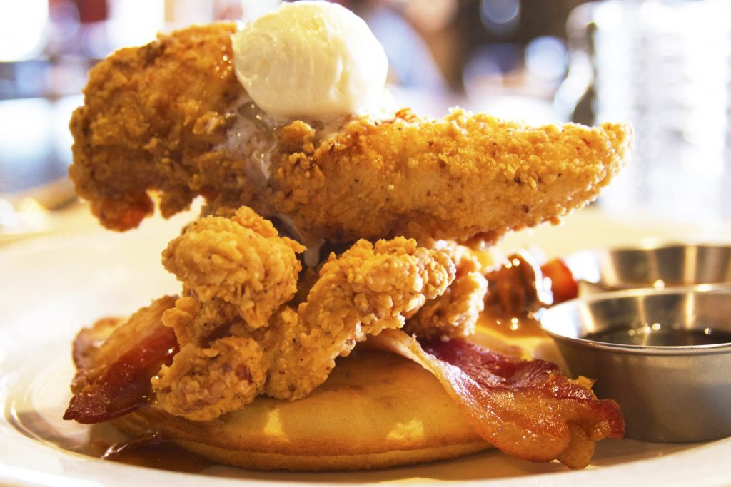 Dig into a pancake skillet with fried chicken and bacon at Mulebone. Photograph courtesy of Mulebone