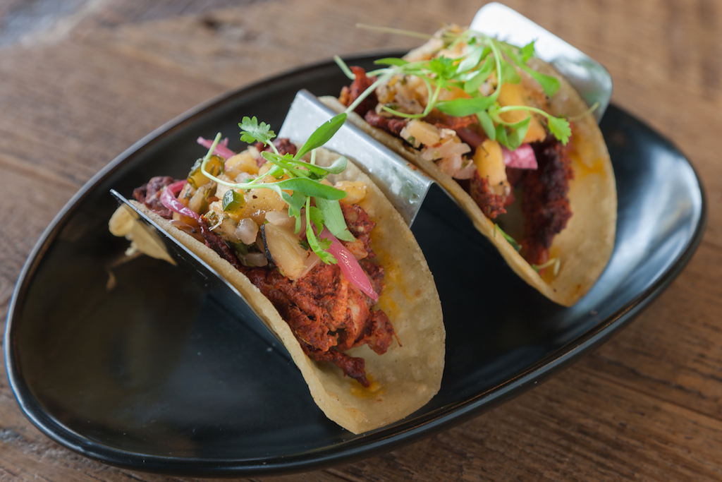 Palette 22 offers eclectic brunch fare, like Cuban sliders and these jerk chicken tacos. Photograph