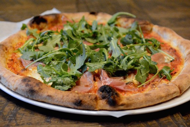 Prosciutto-and-arugula pizza at Alta Strada. Photograph by Laura Hayes.
