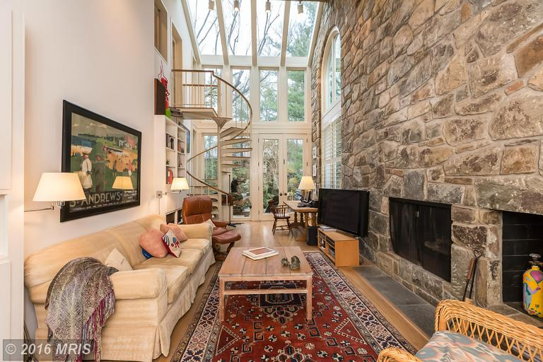 Dramatic stone and glass family room -