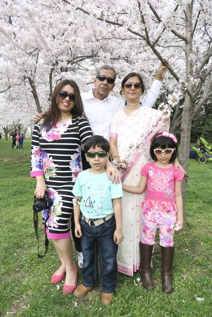 This woman's (left) parents came all the way from India to see the cherry blossoms and their two young grandchildren.