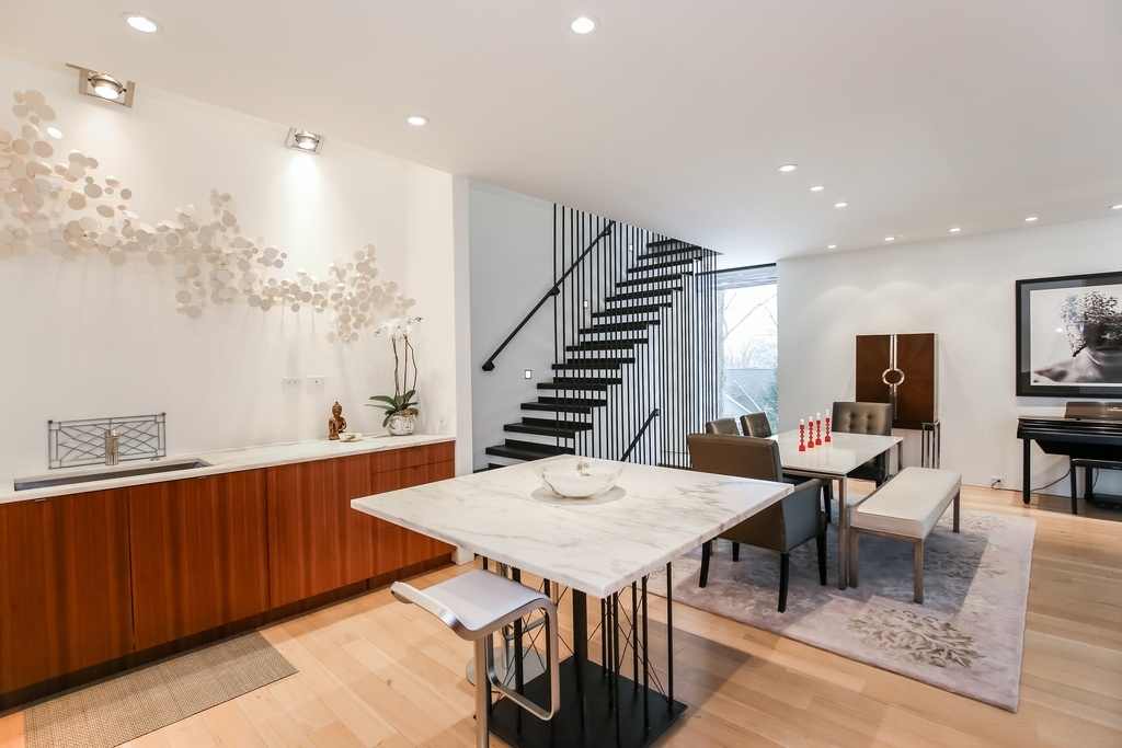 A chef's kitchen and hand-forged staircase are among the homes promising features.