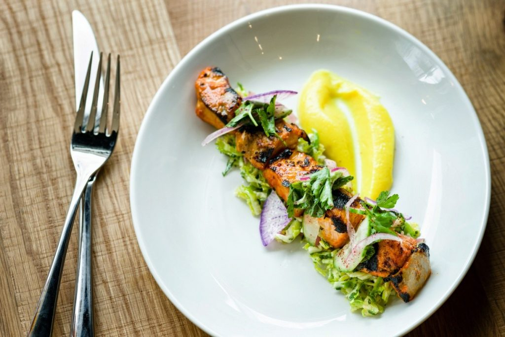 Seafood mezze include options like this spiced salmon kabob with cauliflower puree.