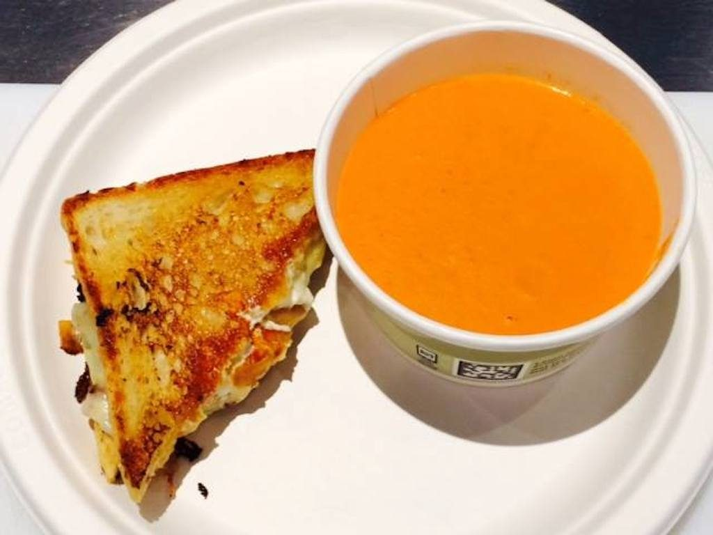 The daily grilled cheese and tomato soup combo can be eaten at Ris, or ordered via delivery. Photograph via Ris Facebook