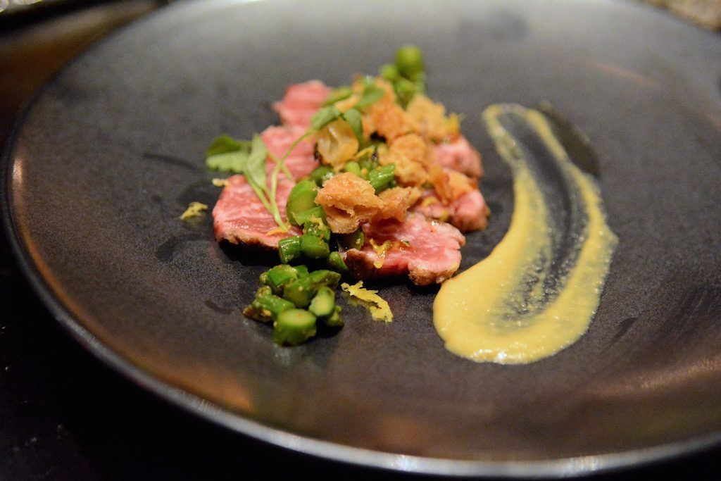 Beef tataki with asparagus and crispy chicken skin.