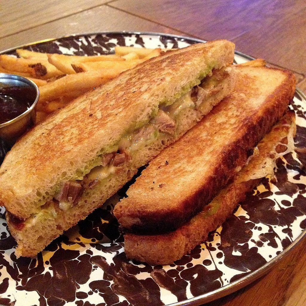 Drafting Table's sandwich combines two of our favorite things: Peking duck pancakes and grilled cheese. Photograph via Drafting Table