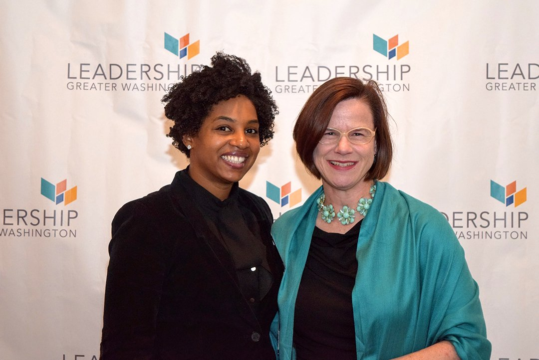 Erica Young ('15) of the Metropolitan Washington Airports Authority, and Blaufuss ('15), CEO of Archbishop Carroll High School.
