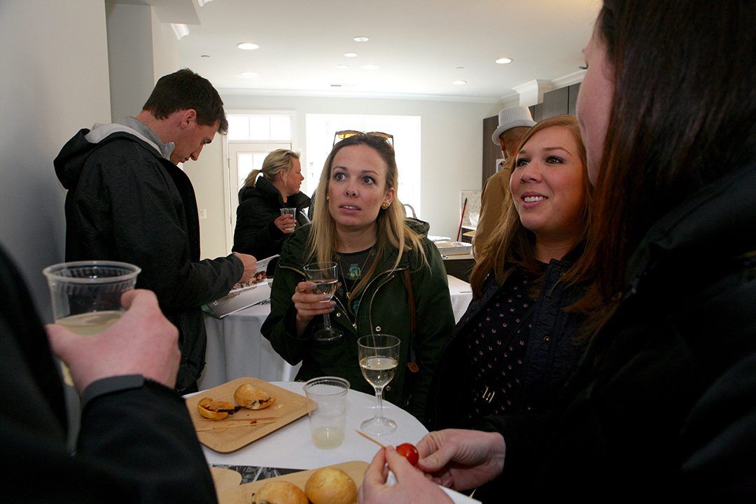 Emily Baird and Remy Kelish enjoy light bites and champagne.