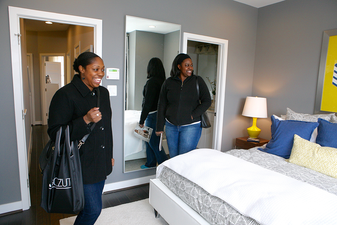 Jenny Reams and Ebony Walker check out one of the model home's second floor bedrooms.