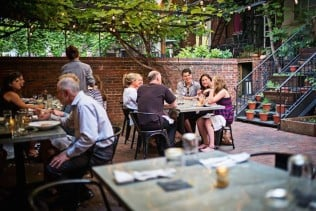 Find a respite from the workday on Iron Gate's patio, open for lunch. Photograph by Scott Suchman.