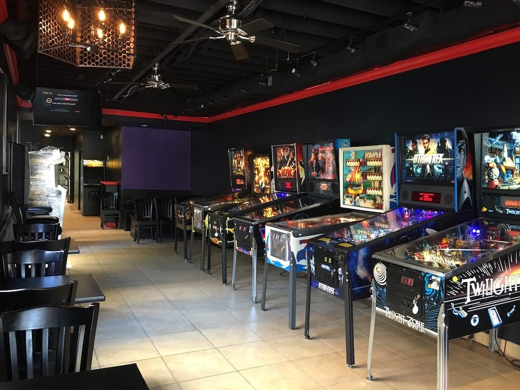Get your pinball and pizza fix at Vuk, which specializes in New York-style pies. Photograph via Facebook