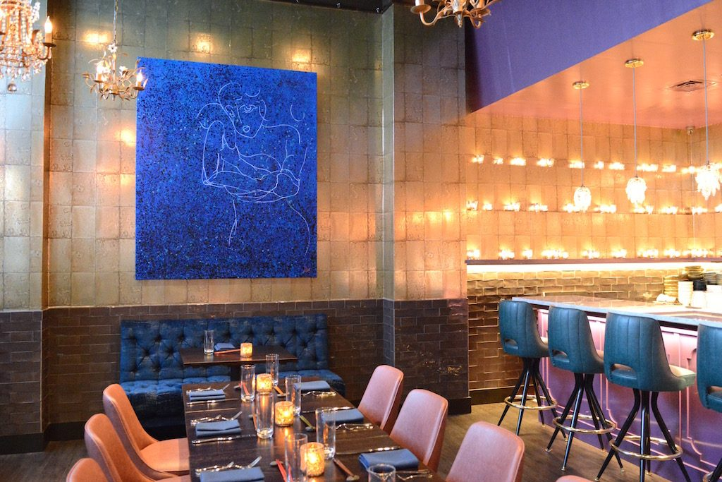 Restaurateur Michael Schlow's crudo bar flickers with candles. Photograph by Laura Hayes