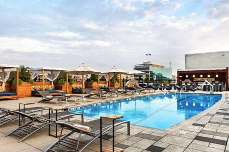 The Liaison hotel on Capitol Hill debuts its new rooftop pool bar for summer fun. Photograph via Facebook