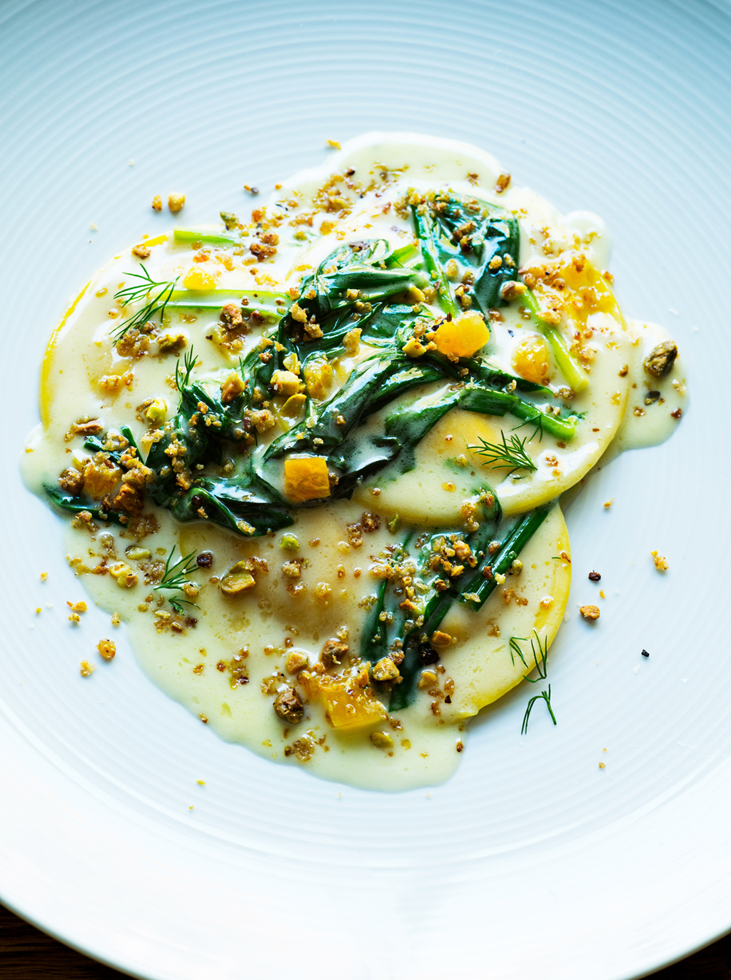 Tail Up Goat's carrot ravioli with apricot. Photograph by Scott Suchman.