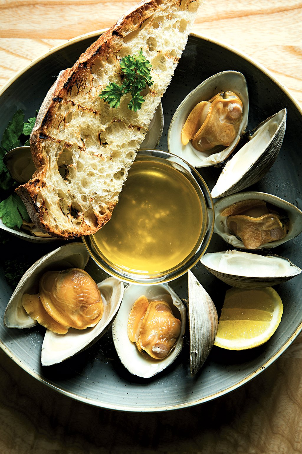 Steamed clams with butter at Ivy City. Photograph by Scott Suchman. (July 2016/Chesapeake Bay)