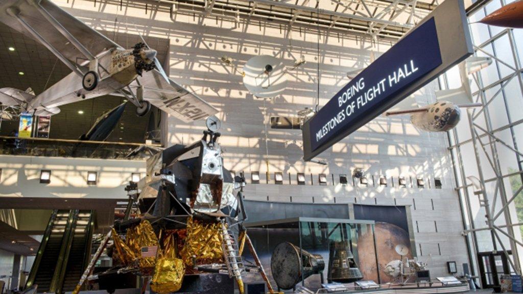 "The Apollo Lunar Module displayed as a centerpiece below the ""Spirit of St. Louis"" in the newly renovated Boeing Milestones of Flight Hall. Photograph by Mark Avino/Smithsonian's National Air and Space Museum."