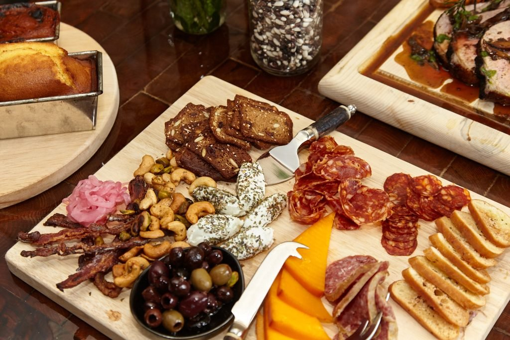 Local cheese and meat boards are designed for group sharing.