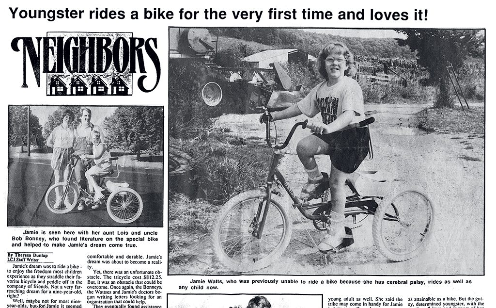 Watts was the only child in her school with a visible disability. When she got her first bike–a special tricycle made abroad–the local newspaper ran a full-page story. Photograph courtesy of Jamie Watts and Carolyn Gregory.
