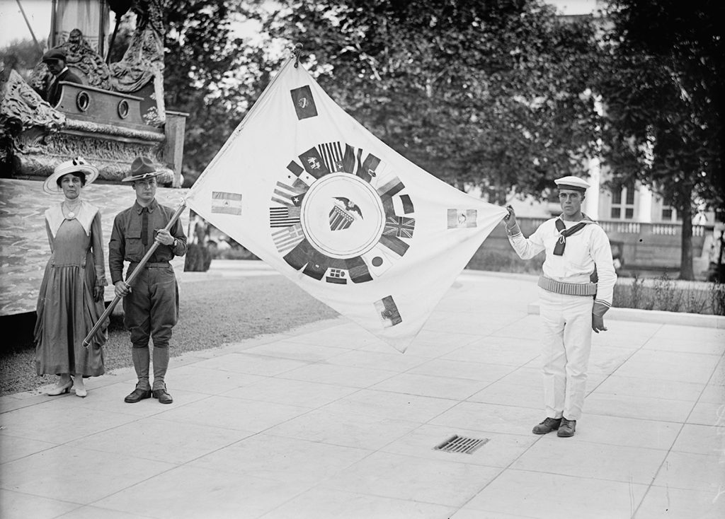 Mrs. J. Wilmuth Gary standing next to an allied flag. Photograph via Harris & Ewing Collection (Library of Congress).