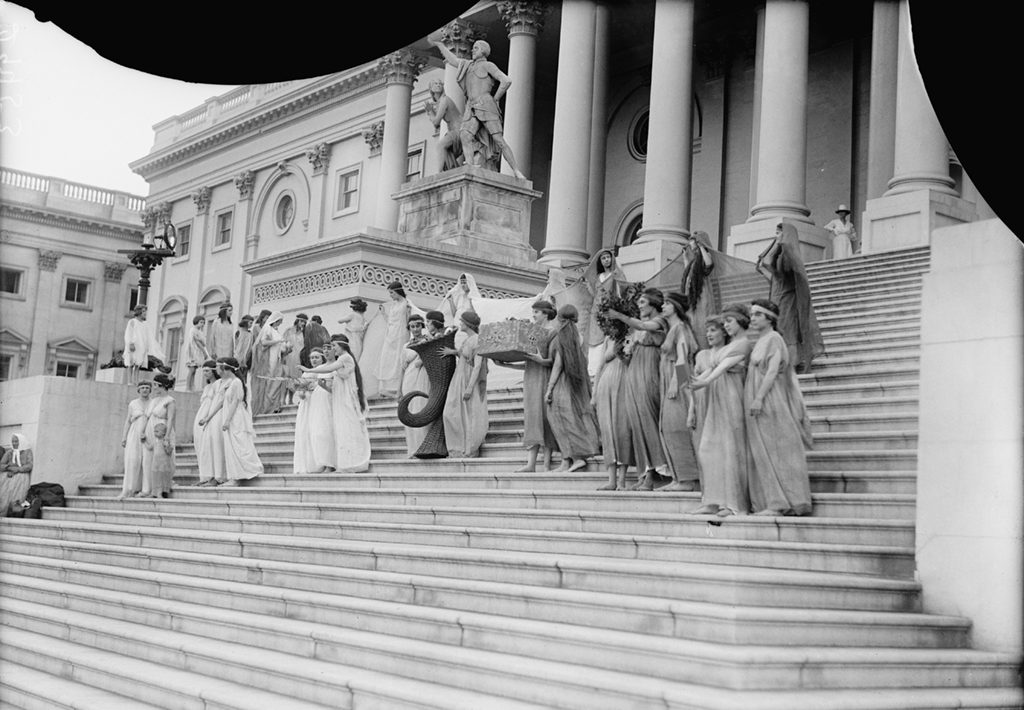 A group posing for photos on the Capitol steps in 1918. Photograph via Harris & Ewing Collection (Library of Congress).