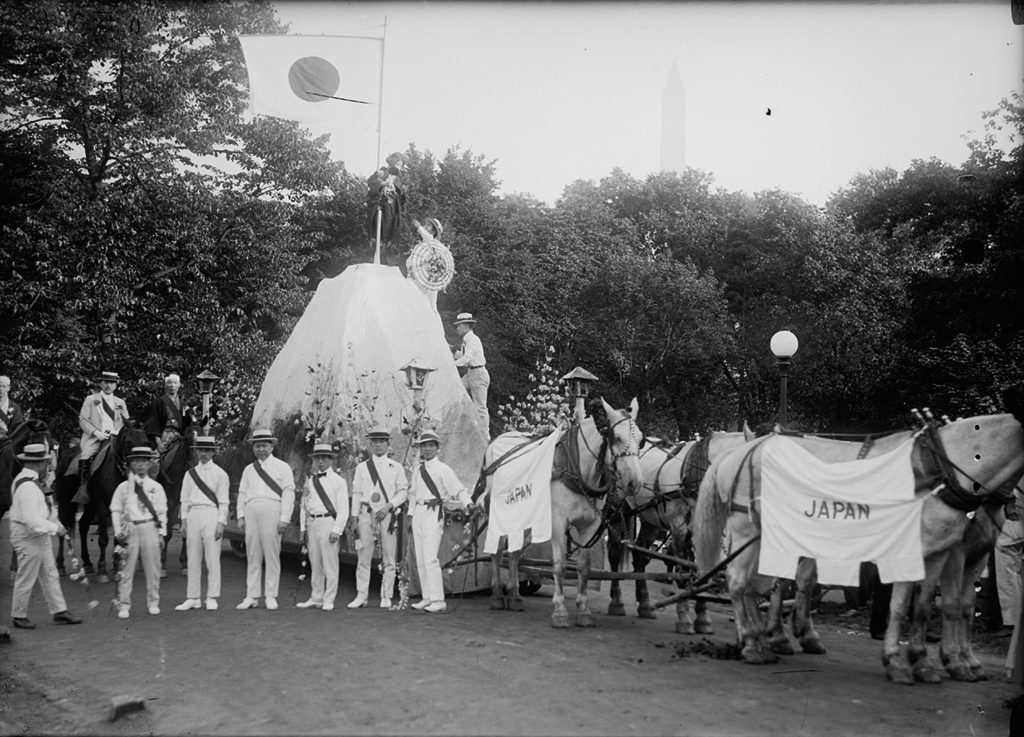 A parade float representing Japan, with the Washington Monument in the background. Photograph via Harris & Ewing Collection (Library of Congress).