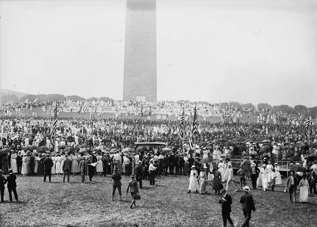 Crowds gathered around the Washington Monument for a Fourth of July celebration. Photograph via National Photo Company Collection (Library of Congress).