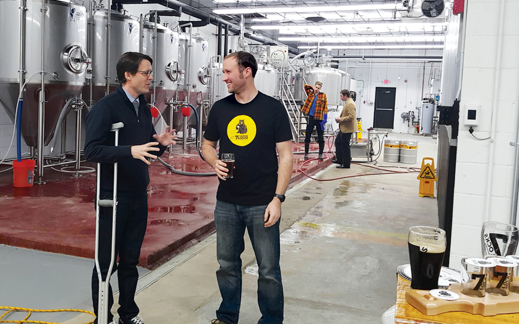 Council member Hans Riemer with Jim Beeman, cofounder of Rockville's 7 Locks Brewing, exempt from the county monopoly because it serves beer made on-site. Photograph courtesy of Hans Riemer.