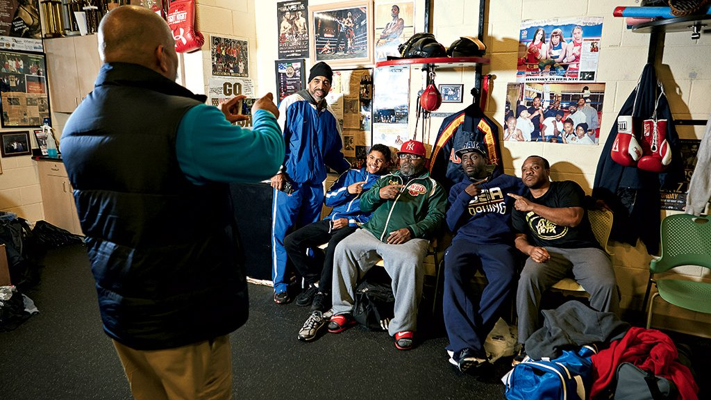 "Pictured, left to right: Michael Johnson, taking photo, Jeff ""Steady"" Johnson, Shakur Stevenson, Porter, Koroma, and Atiba Marshall. All photographs by Noah Willman."